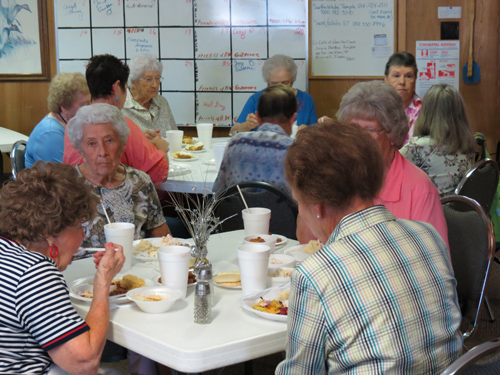 Members of the Over Hill Gang of Liberty Hill enjoy conversation and a home cooked meal at the weekly Thursday luncheon.  All seniors, age 50 or older, are invited to attend and participate in the group's activities. (Dana Delgado Photo)